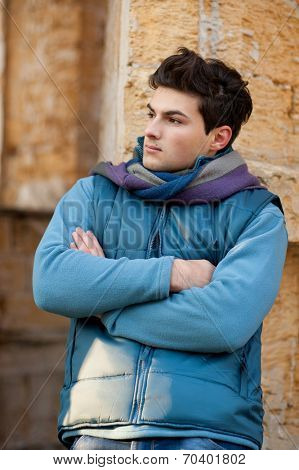 Young stylish arms crossed man outdoor portrait.