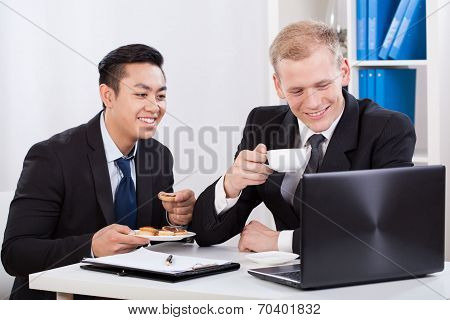 Two Businessmen Eating Lunch