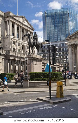 LONDON, UK - JUNE 30, 2014: Busy city of London street, leading to the Bank of England