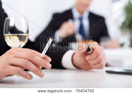 Businessman Drinking Wine And Smoking Cigarettes