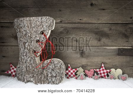 Wooden Christmas Background In Red And Grey With Santa Boot.