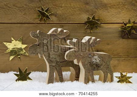 Two Wooden Handmade Reindeer For Christmas Decoration With Natural Materials.