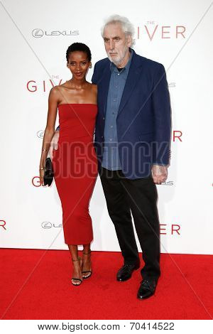 NEW YORK-AUG 11: Director Phillip Noyce (R) and wife Vuyo Dyasi attend the premiere of