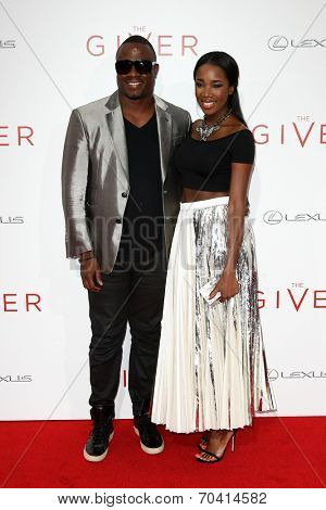 NEW YORK-AUG 11: DJ M.O.S. (L) and DJ Kiss attend the premiere of