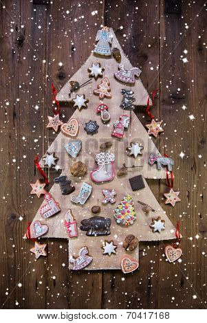 Handmade Carved Christmas Tree Decorated With Gingerbread, Stars And Hearts.