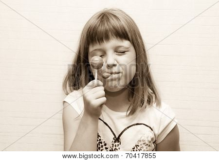 Little Girl Poses And Lick Lollypop