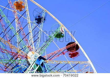 Panoramic Wheel On A Blue Sky Background. Outdoors.
