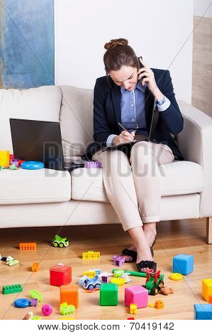 Working Woman Among Child's Toys