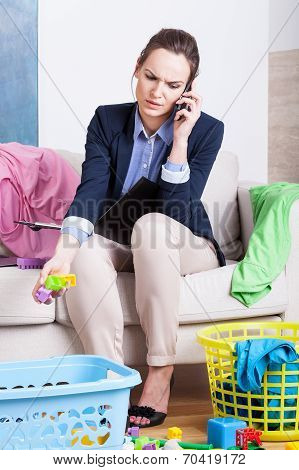 Young Working Mother Talking On Phone