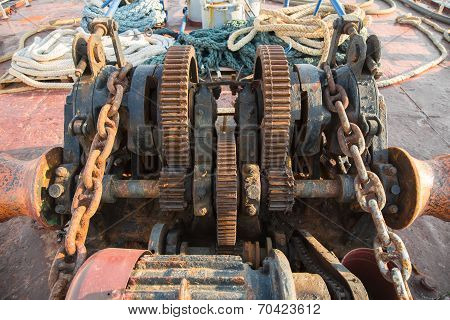 Aged Technology: Old And Rusty Gearwheel On An Old Ship - Retro And Vintage Look.