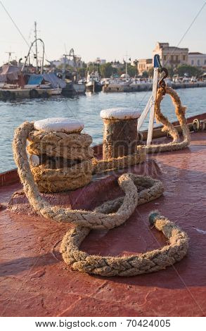 Old Sisal Rope Of An Ancient Ship Fixed On The Docks In The Harbor.