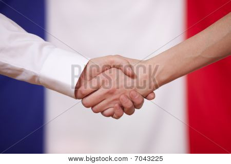 Hand Shake Over France Flag
