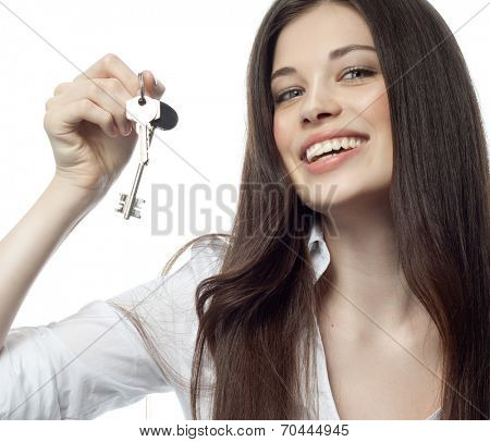 closeup portrait of attractive  caucasian smiling woman brunette isolated on white studio shot lips toothy smile face hair head and shoulders looking at camera businesswoman hand finger pointing to