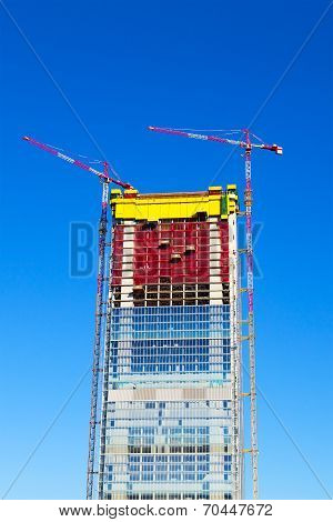 Modern building construction site in Milan Italy.