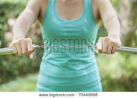 Women Hands Holding a Nunchaku