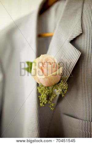 rose boutonniere on seersucker jacket