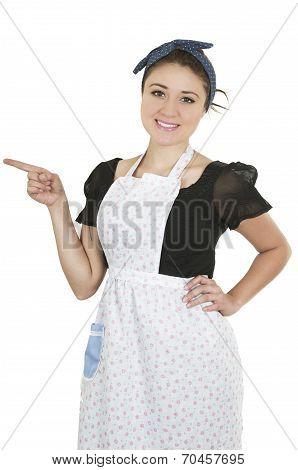 Young beautiful hispanic maid wearing apron