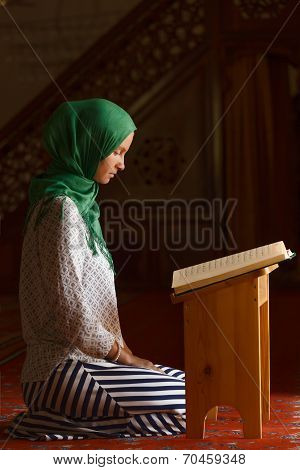 Woman reading Quran