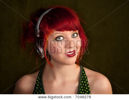 Punky Girl With Red Hair Listening To Music