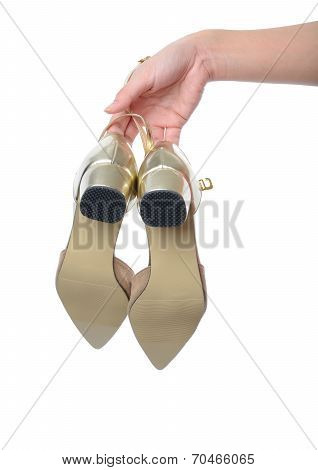 Woman Hand Holding Dress Gold High Heels Shoe