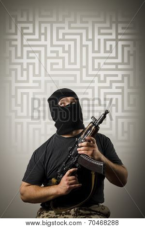 Man With Gun And Maze.