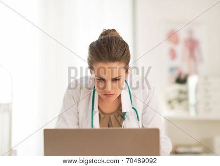 Concerned Doctor Woman Looking In Laptop