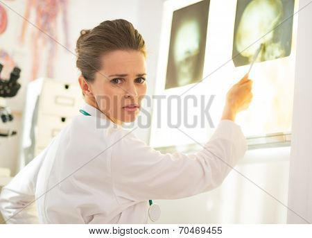 Doctor Woman Pointing On Lightbox