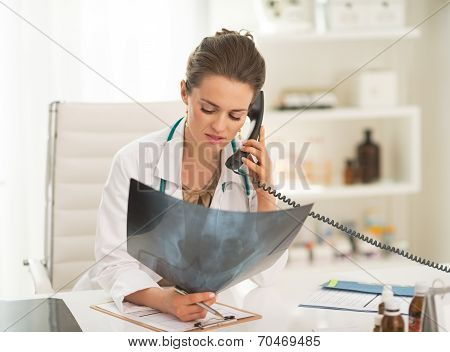 Doctor Woman With Fluorography Talking Phone