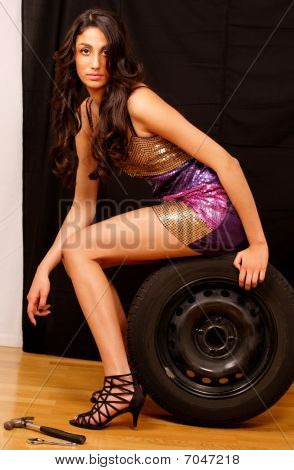 Fashion Model With Car Wheel