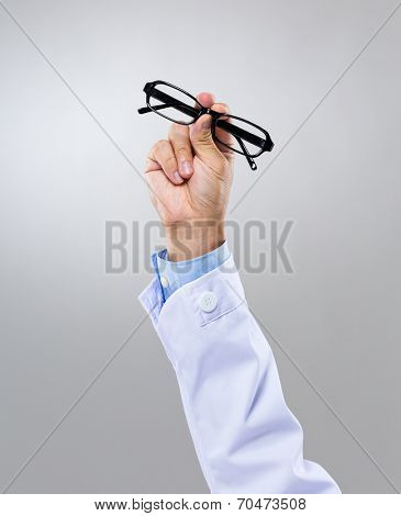 Optician hand with eye glasses