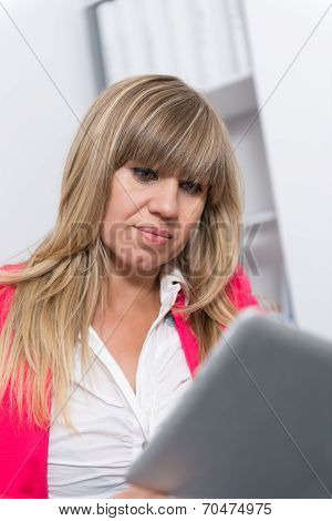 Woman Is Looking At A Tablet
