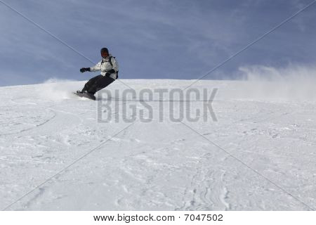 Passionate Guy Sliding On His Snowboard