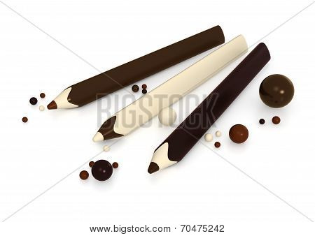 Chocolate Pencils And Balls On White Background
