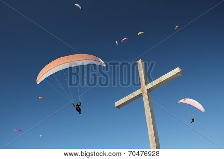 Group Of Paragliders, Floating Above Mountain Cross