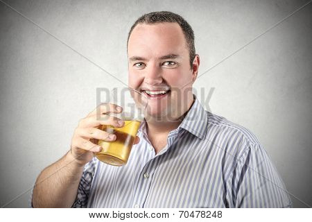 happy man savoring a beer
