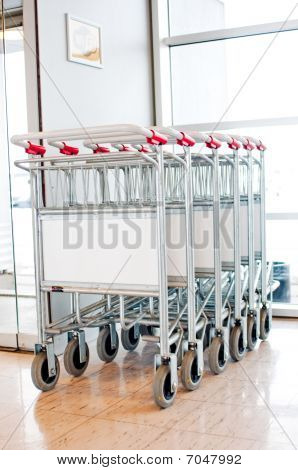 Baggage Trolleys In A Row In The Departures Area In The Airport