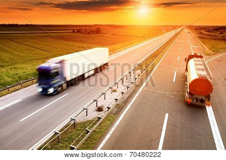 Two Trucks In Motion Blur On The Highway