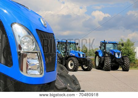 Group Of New Holland Agricultural Tractors On Display