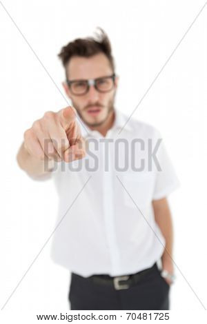 Nerdy businessman pointing at camera on white background