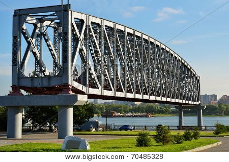 NOVOSIBIRSK, RUSSIA - AUGUST 8, 2014: Truss of the old railroad bridge across the Ob river. This bridge predetermined the foundation of the Novosibirsk city