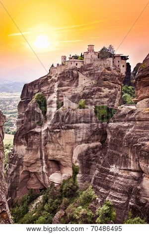 Rocky monastery at Meteora in sunset, Trikala region, Greece.