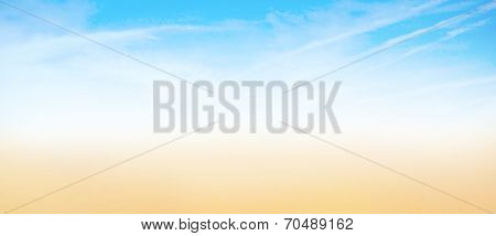 Abstract artistic background texture of sunny yellow golden sand beach and cloudless blue sky in fairy paradise with strip of light white mirage and illusion, horizontal panoramic and perspective view