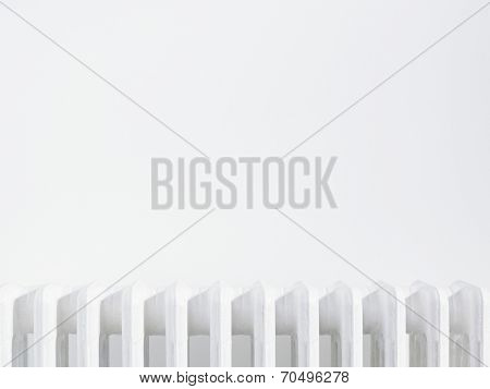 Close up of radiator against white wall