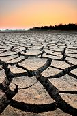 pic of water shortage  - dry cracks in the land serious water shortages