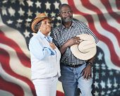 stock photo of tribute  - A mature western couple giving tribute to their country - JPG