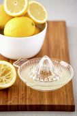 picture of juicer  - Bowl of lemons and juicer on cutting board - JPG