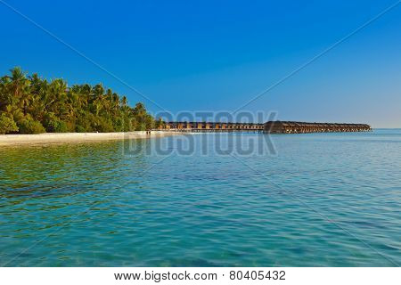 Water bungalows on tropical Maldives island - nature travel background