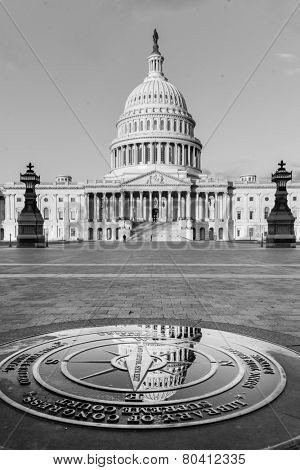 Reflection of Capitol dome over the symbolic compass on the ground. - Washington DC, United States