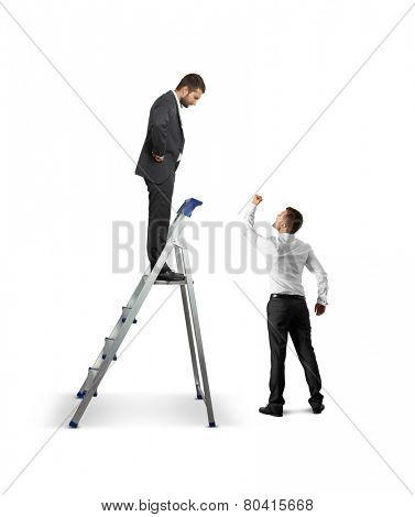 strict businessman standing on stepladder and looking down at screaming showing fist man. isolated on white background