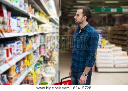 Handsome Young Man Shopping In A Grocery Supermarket